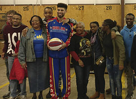 18+ Students Team Up with a Harlem Globetrotter